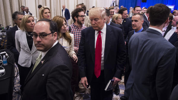 "Republican presidential candidate Donald Trump at Tuesday's press conference in Jupiter, Fla., where Breitbart reporter Michelle Fields, seen to the left of Trump, says ""someone had grabbed me tightly by the arm and yanked me down."""