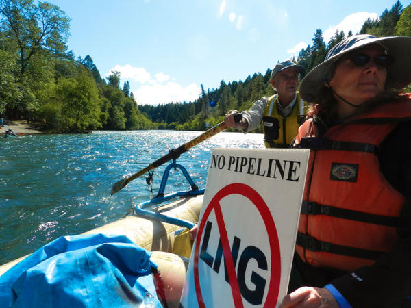 """<p>""""Hike the Pipe"""" supporters on Rogue River show opposition to the Jordan Cove liquefied natural gas project.</p>"""