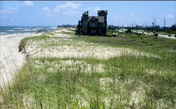 <p>Rodanthe, Cape Hatteras, North Carolina, 1999. Large beach house sitting on dunes, which have been replanted as protection against erosion on this barrier island.</p>