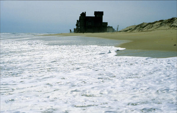 <p>Rodanthe, Hatteras Island, North Carolina, 2004. The house is now at the edge of the surf, the dune having been completely washed away by storms, increased wave action and sea level rise. The area is losing 12 feet each year on average.</p>