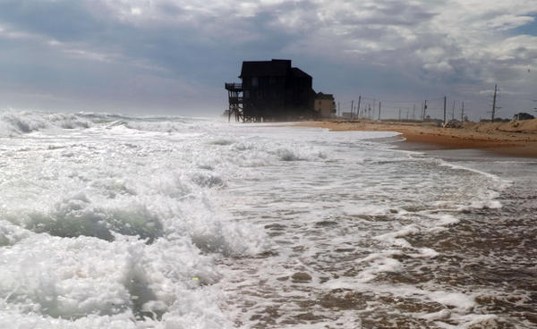 <p>Rodanthe, Hatteras Island, North Carolina, 2011. The large house in previous photos has been moved and two others next to it have been washed away as erosion continues rapidly. Hurricane Irene opened new inlets in this island in this location, severely damaging many homes.</p>