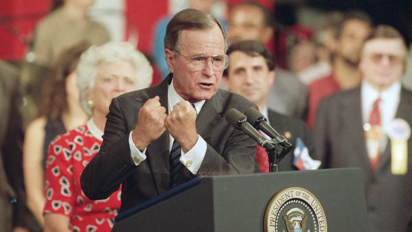George H.W. Bush shakes his fists during a speech to supporters in 1992 at the Republican National Convention in Houston.