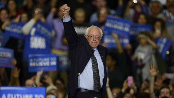 Bernie Sanders waves as he leaves the stage at a rally in Illinois.