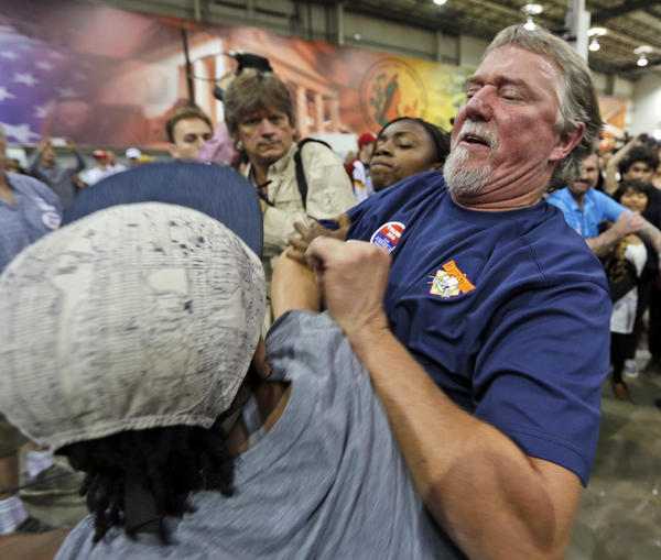 A Trump supporter and protester get into a scuffle at a rally in Richmond, Va., in October. Protests and violence are becoming more frequent at Trump rallies, but they have been going on for months.