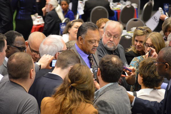 Rev. Jesse Jackson speaks to the media before the event