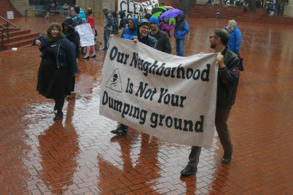 <p>A few dozen protesters gathered in Portland's Pioneer Courthouse Square before marching to the nearby Department of Environmental Quality office. They want tighter regulation of industrial air emissions.</p>
