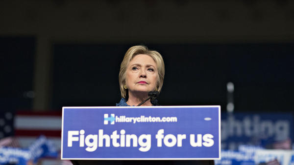 Hillary Clinton pauses while speaking during her primary-night rally in West Palm Beach, Fla., on Tuesday.