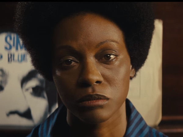 This still is from the first trailer for <em>Nina, </em>starring Zoe Saldana as singer Nina Simone. This image of Saldana in dark makeup and with a prosthetic nose helped reignite a controversy over skin color and casting.