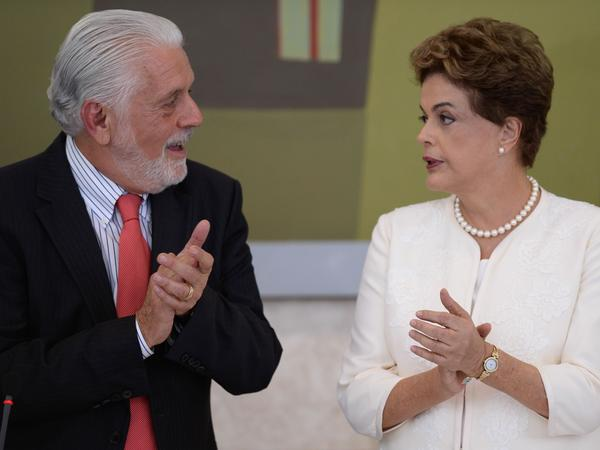 "Brazil's President Dilma Rousseff speaks with her chief of staff, Jaques Wagner, in January. Wagner was recorded telling Silva, the former president, it was ""good"" that a female opposition politician was called a ""whore."""