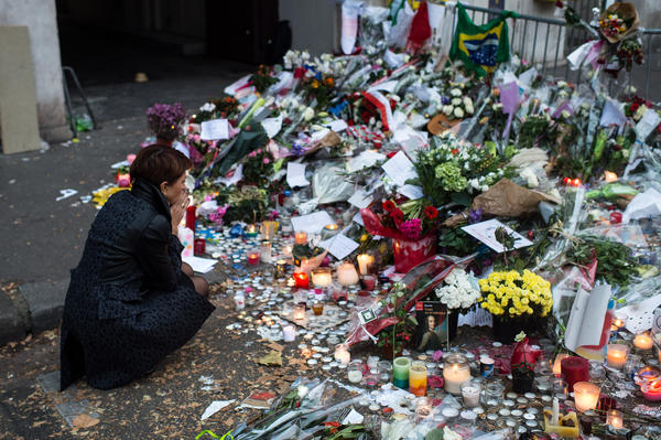 A woman visits a memorial Nov. 16 near the Bataclan concert hall in Paris. The attack on multiple locations in Paris last fall left 130 dead.