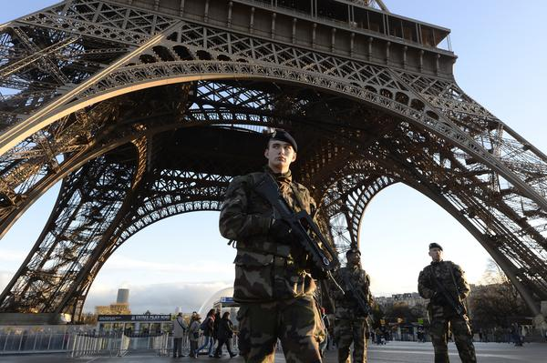 French soldiers patrol in front of the Eiffel Tower on Jan. 8, 2015, the day after a deadly attack on the French satirical newspaper <em>Charlie Hebdo</em>. With bombings Tuesday in Brussels, Europe has now been hit by three major terrorist attacks in just over a year.