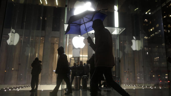 A pedestrian walks by an Apple store in New York City on Feb. 23. Protesters demonstrated against the FBI's efforts to require the company to make it easier to unlock the encrypted iPhone used by Syed Rizwan Farook.