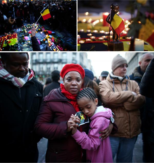 People gather to leave tributes at the Place de la Bourse following Tuesday's attacks in Brussels, Belgium.