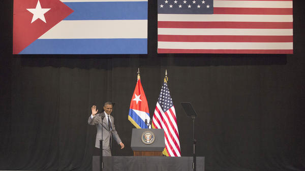 President Obama arrives at the podium to address the Cuban people at the National Theater in Havana on Tuesday. He said the two countries should let go of the past and benefit from better relations in the future.