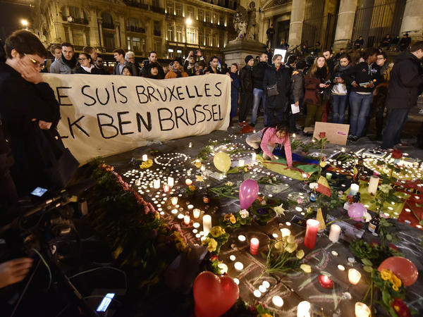 "Mourners hold a banner reading ""I am Brussels"" at Place de la Bourse in the center of Brussels on Tuesday night."