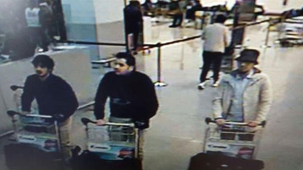 This image, provided by the Belgian Federal Police in Brussels, shows Ibrahim el Bakraoui (center), an unidentified attacker (left) and a wanted suspect (right) whose whereabouts are currently unknown.