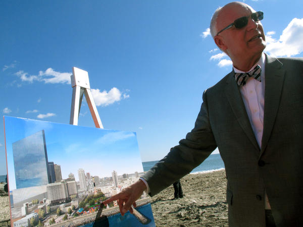 Mayor Don Guardian examines an artist's rendering of a boardwalk reconstruction project in October. Without a cash infusion, Guardian says all nonessential city services will shut down on April 8.