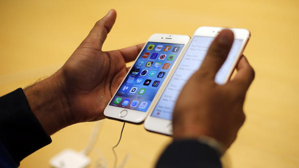 "A customer tries out a new iPhone at an Apple store in Chicago. The FBI is working with a ""third party"" to test a method of seeing what's inside the iPhone used by one of the San Bernardino shooters without Apple's help."