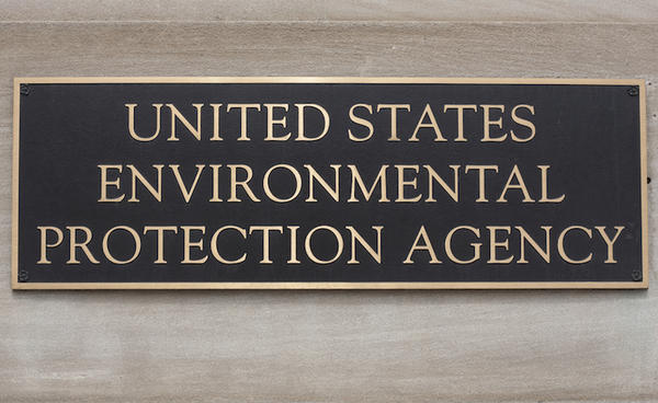 "The sign in front of the EPA's Washington D.C. office. While the chemical PFOA has since been classified by the EPA as an ""emerging contaminant,"" the agency has a difficult time regulating the chemical."
