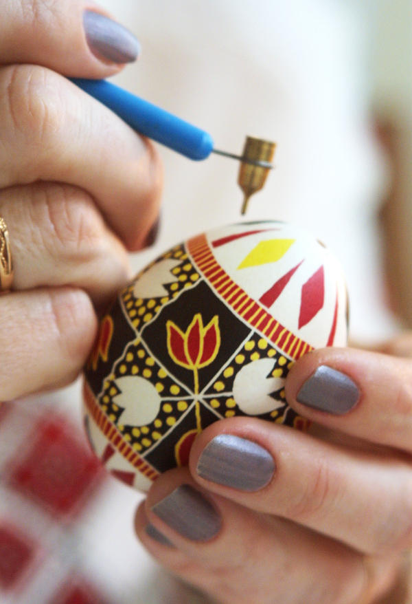 "Famous Ukrainian Easter egg artist Galina Ivanets paints her creation with a writing pin in her workshop in Kiev, Ukraine. <em>""Pysankarstvo</em>"" — the art of painting Easter eggs — has enjoyed a renaissance as part of the religious and cultural awakening in post-Soviet Ukraine following decades of state-sponsored atheism."