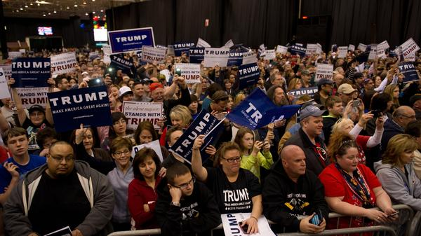 Supporters listen as Republican presidential candidate Donald Trump speaks at a campaign event at the I-X Center earlier this month in Cleveland, Ohio.