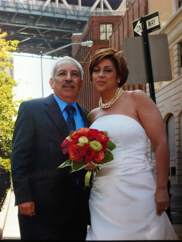"""Eva Vega-Olds on her wedding day in May 2009 with her father, Leonardo Vega. As he walked her down the aisle, he cracked a joke in their family's characteristic sarcasm, telling her: """"It's my day. I finally get rid of you."""""""