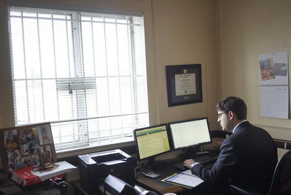 Aaron Sokolow, a Washington, D.C., real estate lawyer, works in his office. Sokolow says some tenants use complaints about poor conditions to justify not paying their rent. He says his clients need rent payments so they can pay their bills and maintain the apartments.