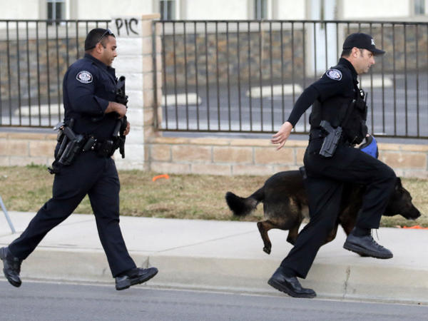 Authorities search for a suspect following the shooting that killed 14 people on Dec. 2, 2015, in San Bernardino, Calif. The public was able to follow the manhunt by listening to police radio communications streaming online.
