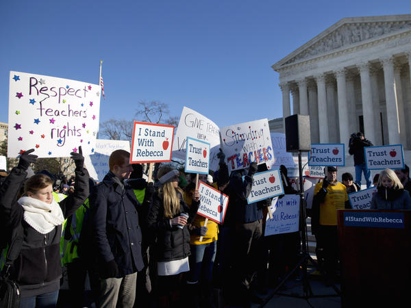 People rally at the Supreme Court in Washington in January, as the court heard arguments in <em>Friedrichs v. California Teachers Association</em>.