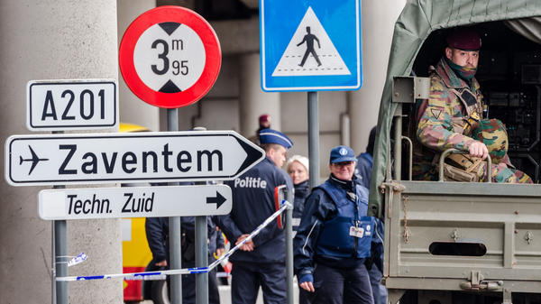 Belgian police and soldiers secure the area outside the Zaventem Airport in Brussels on Tuesday. The airport has been closed since the March 22 suicide bombing, and there's still no date for reopening it.