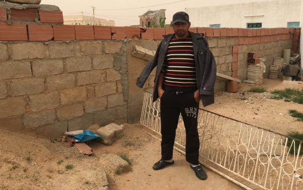 Jilan Abdul Kabir stands next to the spot where his cousin Abdul Atti al-Kabir was shot and killed by ISIS militants in a battle earlier this month in southern Tunisia, near the Libyan border.