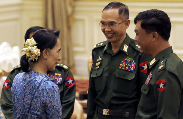 Aung San Suu Kyi (left) speaks with military generals during the presidential handover ceremony in Naypyitaw, Myanmar on Wednesday. Suu Kyi, a Nobel Peace Prize laureate, will hold several top positions in the new civilian government, including the post of foreign minister.