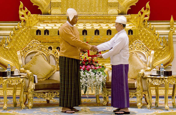 Myanmar's new president U Htin Kyaw (left), receives the presidential seal from outgoing president U Thein Sein during a handover ceremony at the presidential palace in Naypyidaw on Wednesday. The military ruled Myanmar, directly or indirectly, for more than a half-century.