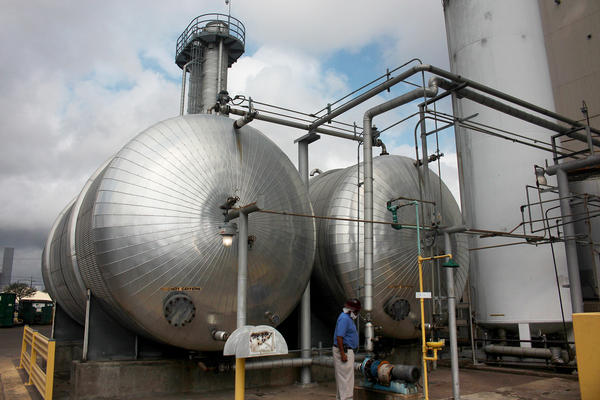 Boris Wheatley, a manager at Atlantic Coffee Solutions, inspects two tanks filled with a mixture of hot water and caffeine. The water will be evaporated to obtain crude caffeine powder.
