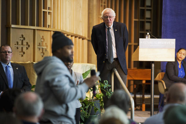 Democratic presidential candidate Bernie Sanders listens to concerns about contaminated water during a community forum at Woodside Church in Flint, Mich.