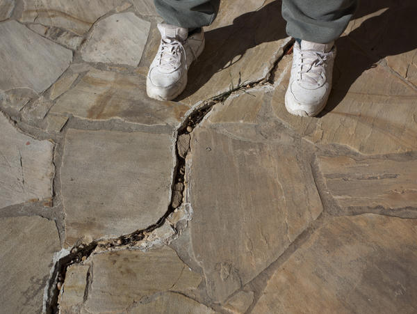 Large cracks in the sidewalk in Coyle, Okla., appeared after several earthquakes on Jan. 24.