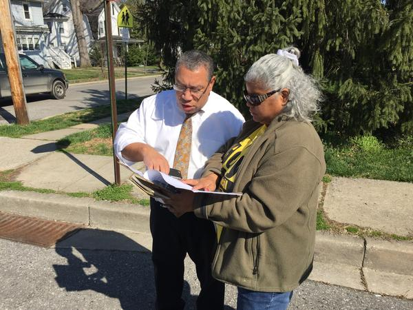 Councilman Bill Henry with his sister, Lenora Henry, looking at a list of where they need to campaign in Kenilworth Park.