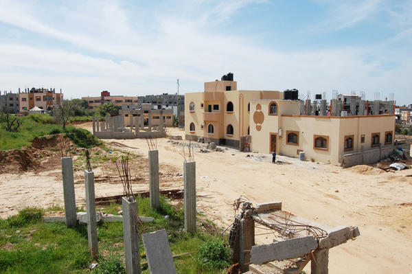A view of Gaza City's Shujaya neighborhood shows this rebuilt home surrounded by others that were destroyed in 2014 and have not yet been reconstructed.