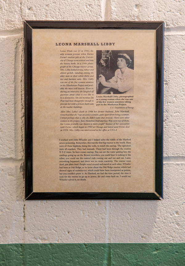 Since Leona (Woods) Marshall Libby was the only woman working at B Reactor, they had to construct a women's bathroom especially for her. This framed informational sheet is posted outside the bathroom.