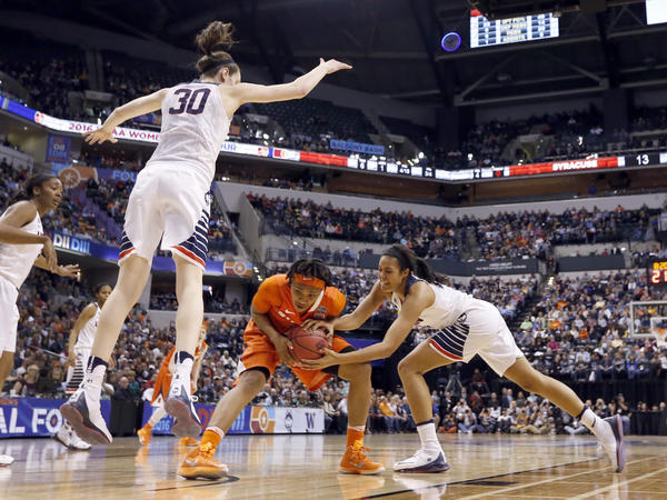 Syracuse's Cornelia Fondren, (center) and Connecticut's Napheesa Collier (right) battle for a loose ball as UConn's Breanna Stewart goes airborne, preparing to block a shot in the first half of the NCAA championship game.