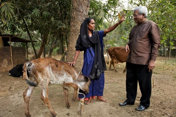 "Abed meets with a Bangladeshi villager who was given a cow as part of BRAC's ""graduation program."""