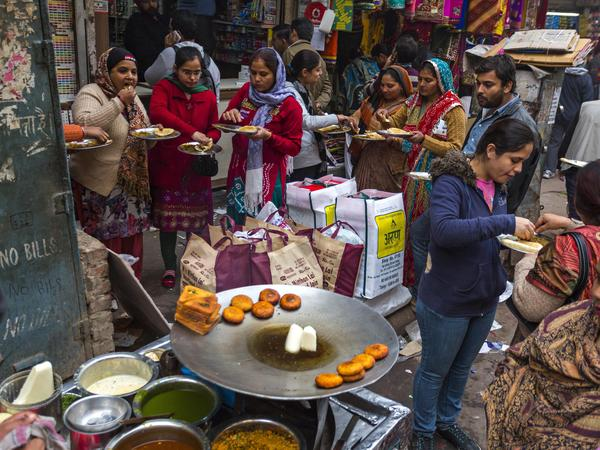 As regions of the world climb out of poverty, people eat more of whatever they'd been traditionally eating. Above: a scene from the market in Delhi, India.
