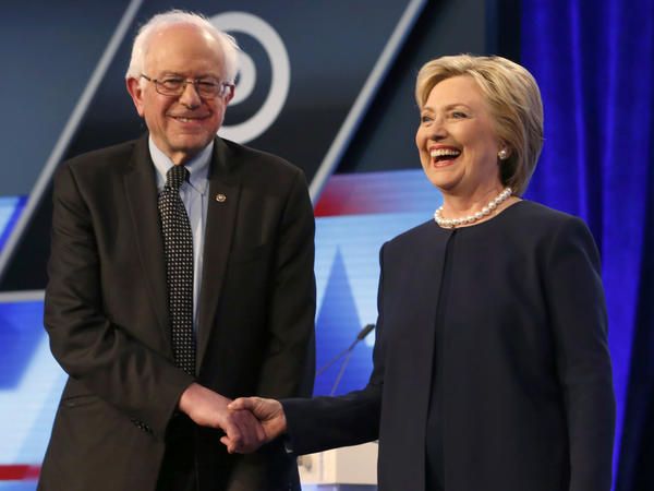 Democratic presidential candidates Hillary Clinton and Bernie Sanders shake hands before the start of the <em>Washington Post-</em>Univision Democratic presidential debate at Miami-Dade College in Miami on March 9.