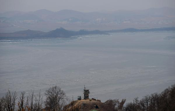 A photo taken on February 8 shows a South Korea military post in front of the Demilitarized Zone and the North Korean shore line, seen from Paju.