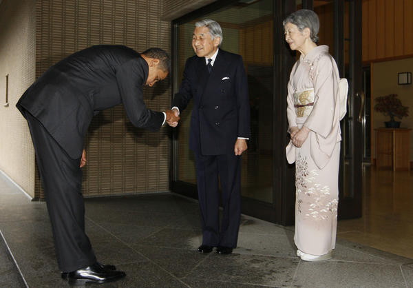 President Obama bows as he greets Japanese Emperor Akihito and Empress Michiko at the Imperial Palace in Tokyo in 2009. The president travels to Japan next month and there's speculation he might visit Hiroshima, the site of the world's first atomic bombing.