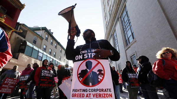 Verizon workers picket outside one of the company's facilities in Philadelphia Wednesday. Verizon landline and cable workers on the East Coast walked off the job Wednesday morning after little progress in negotiations since their contract expired nearly eight months ago.