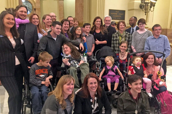 Families and children who use medical marijuana took a picture outside the House Agriculture, Livestock and Natural Resources Committee after HB 16-1373 cleared by a 10-3 vote. The law to allow access in schools now goes to full House vote.