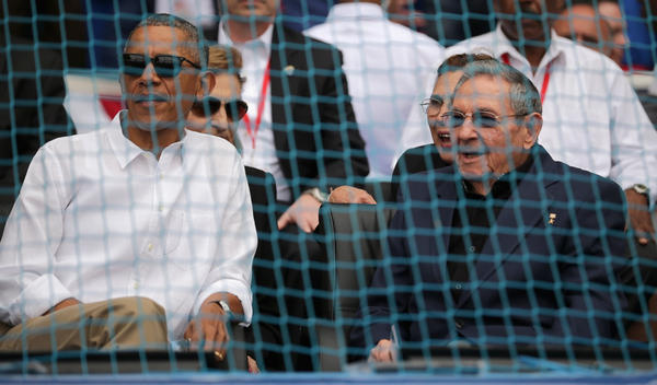 President Obama and Cuban President Raul Castro attend a baseball game during Obama's visit to Havana on March 22. The U.S. has opened up to a number of longtime foes in recent years, including Cuba. This has raised a debate about whether this leads to improved human rights in these countries.