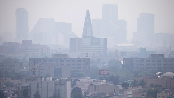 Smog blankets scyscrapers in Mexico City on March 17. The city is suffering its worst pollution in more than a decade, and cars are required to stay off the street one day a week.