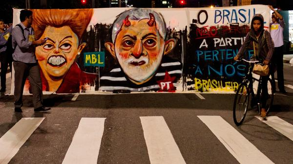Protesters last month vent their anger over President Dilma Rousseff (left) moving to appoint her predecessor, Luis Inacio Lula da Silva, as her chief of staff — an action that would have shielded him from prosecution. A court blocked him from the post. Rousseff faces the possibility of impeachment while Lula is under investigation for corruption.